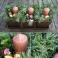 Kerststukje drie op een rij
